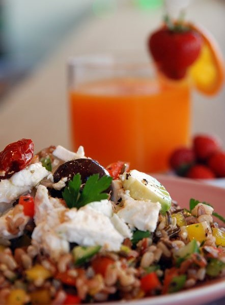 Gourmet mixed rice salad with peppers, feta cheese and fresh herbs