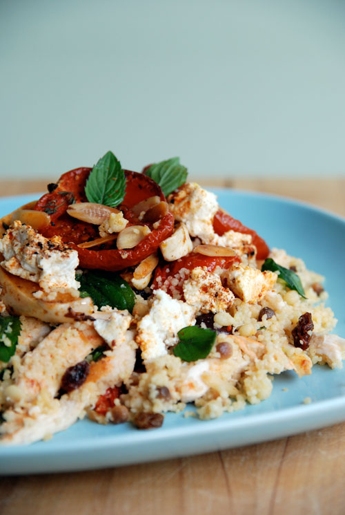 Spicy roasted chicken salad with couscous, fregolone, roasted tomatoes and ricotta with saffron and herbs