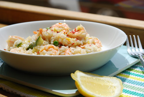 King prawn, courgette and pea risotto with lemon-infused oil and pink peppercorns