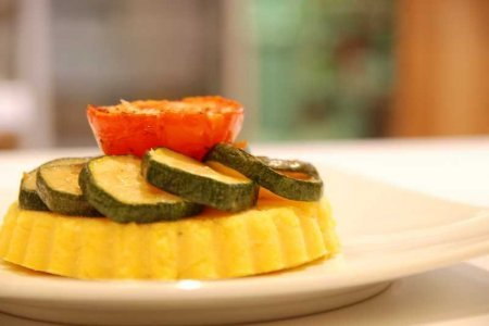 Roasted parmesan and polenta tartlet with courgettes and slow roasted tomatoes